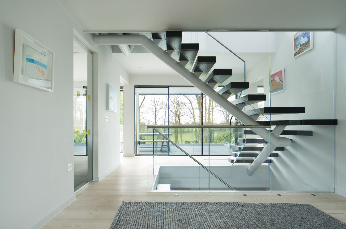 The See Through House On Two Floors And Basement Has A Central Feature  Floating Staircase, And Lots Of Glass To Soak Up The View.